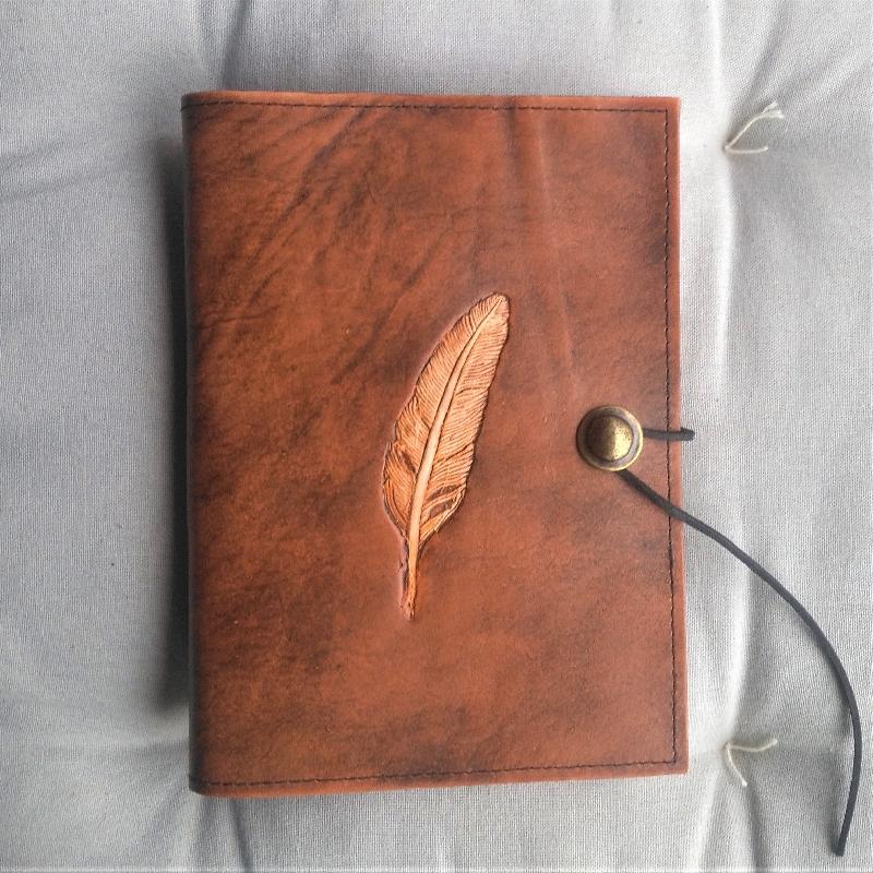 Buch A5 Feder